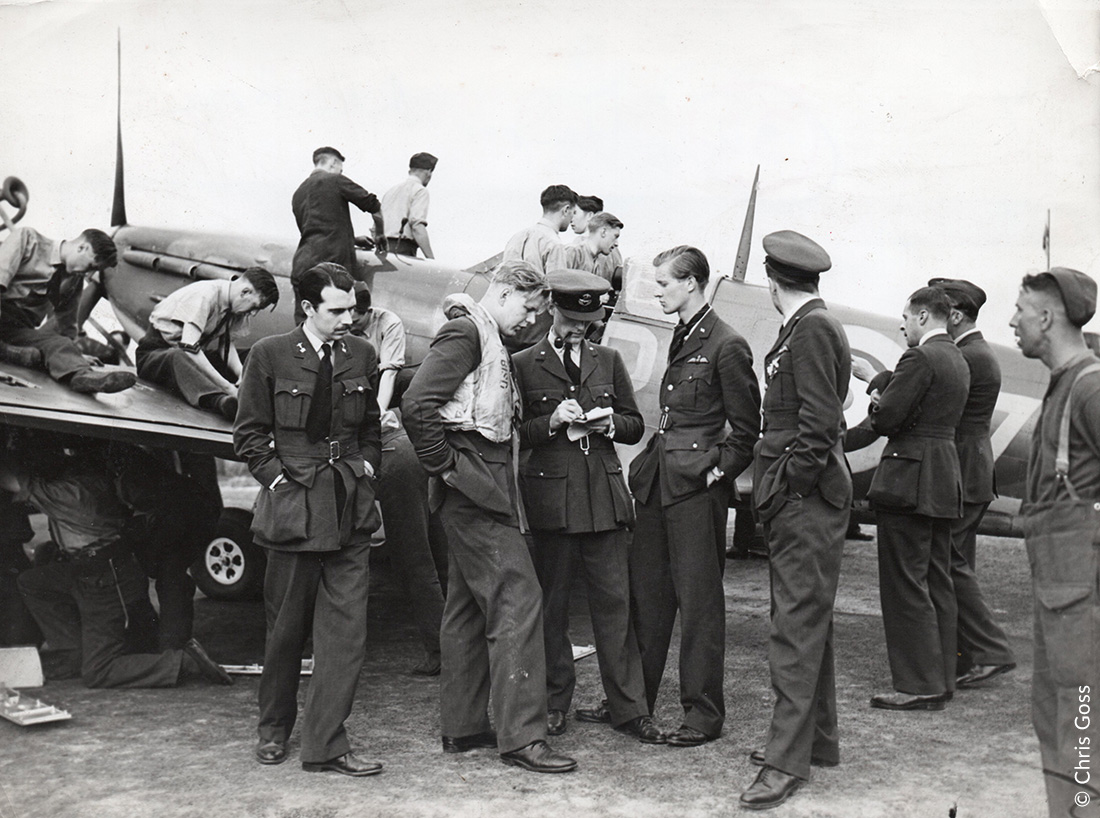 Turning round a Spitfire of 609 Sqn-in the middle, Flt Lt John Bisdee is being debriefed by the Intelligence Officer Plt Off Franz Ziegler