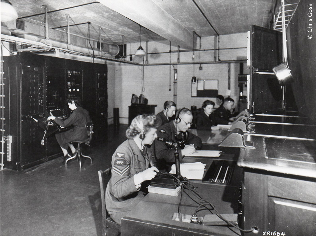 RAF and WAAF personnel working in the receiver room of a radar station
