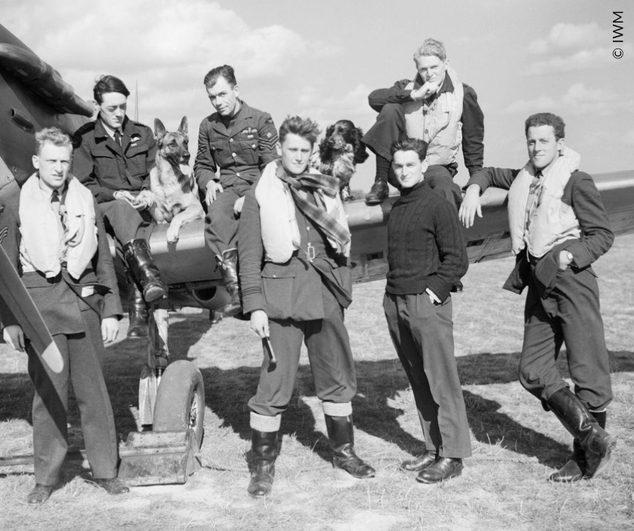 Pilots of No.19 Squadron pose alongside a Spitfire at Fowlmere, 21 September 1940.